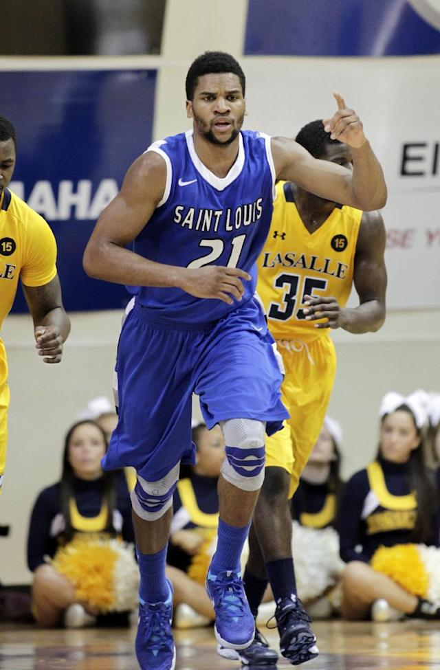 Saint Louis' Dwayne Evans (21) celebrates after he scored against La Salle in the first half of an NCAA college basketball game, Saturday, Feb. 8, 2014, in Philadelphia. (AP Photo/H. Rumph Jr.)