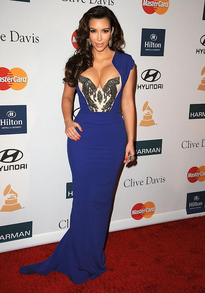 Kim Kardashian was busting out of her Antonio Berardi gown at Clive Davis' Pre-Grammy Gala last Saturday. Although the color and shape suited the reality star just fine, the jeweled inlay looked more like a torture device for her infamous cleavage rather than fashionable flair. (2/11/2012)
