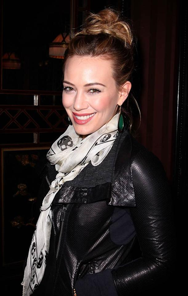 "Sporting a cute skull-print scarf and form-fitting black jacket, Hilary Duff was all smiles as she signed copies of her new book <i>Elixir</i> at Hotel Costes in Paris, France on Thursday. Marc Piasecki/<a href=""http://www.wireimage.com"" target=""new"">WireImage.com</a> - February 3, 2011"
