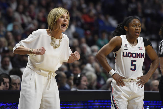 Connecticut associate head coach Chris Dailey, left, and Connecticut's Crystal Dangerfield react in the first half of an NCAA college basketball game against Oklahoma, Sunday, Dec. 22, 2019, in Uncasville, Conn. (AP Photo/Jessica Hill)