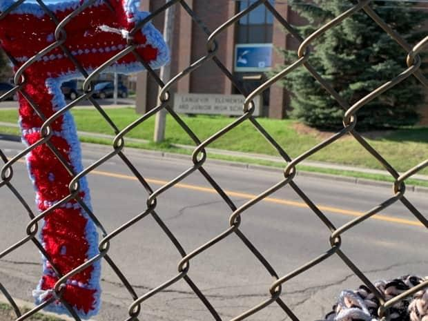 Community knitters created these knitted sevens in partnership with the Change Langevin School Committee to serve as a reminder of Treaty 7, which covers much of southern Alberta.