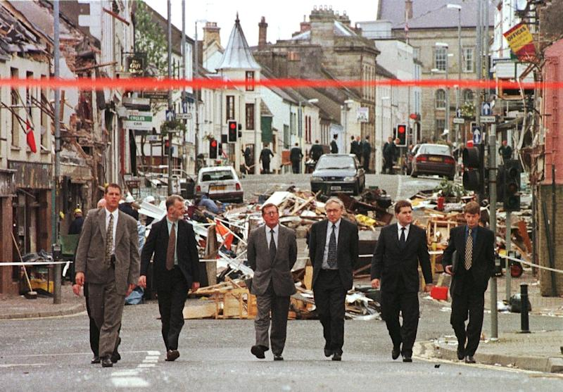 Northern Irish officials inspect the damage after the 1998 Omagh bombing -- the single worst atrocity of the sectarian conflict known as The Troubles (AFP Photo/Paul Vicente)