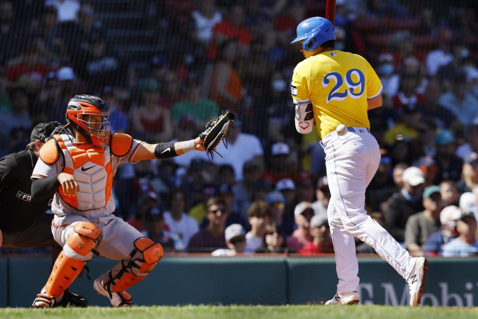 Boston Red Sox's Bobby Dalbec (29) is hit by a pitch in front of Baltimore Orioles' Pedro Severino, allowing Rafael Devers to score with the bases loaded during the first inning of a baseball game, Sunday, Sept. 19, 2021, in Boston. (AP Photo/Michael Dwyer)