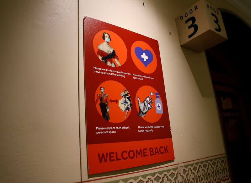 A welcome back sign requesting that people maintain precautions, is seen at the Royal Albert Hall in London