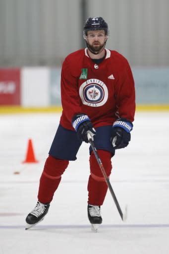 Winnipeg Jets' Josh Morrissey (44) skates during the first day of the NHL training camp in Winnipeg, Manitoba, Friday, Sept. 13, 2019. (John Woods/The Canadian Press via AP)