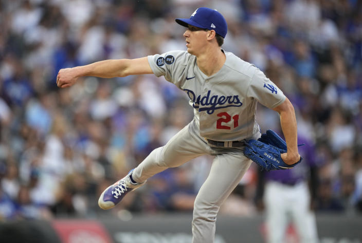 Los Angeles Dodgers starting pitcher Walker Buehler follows through on a delivery to a Colorado Rockies batter during the fifth inning of a baseball game Saturday, July 17, 2021, in Denver. (AP Photo/David Zalubowski)