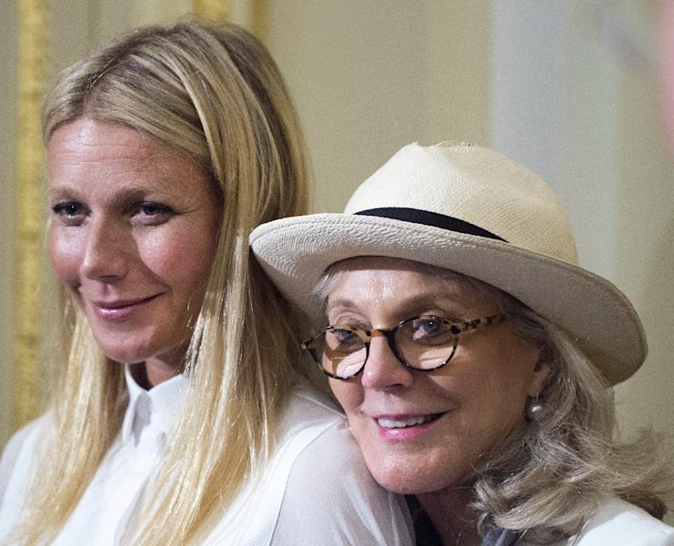 Academy award-winning actress Gwyneth Paltrow (L), and her mother actress Blythe Danner, pause for a photo as they leave a press conference regarding the importance of GMO labeling on August 5, 2015, in Washington, DC (AFP Photo/Paul J. Richards)