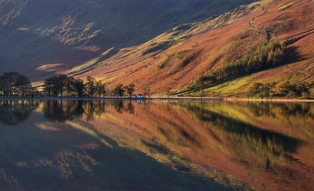 Autumnal reflections in lake Buttermere in the Lake District, Cumbria