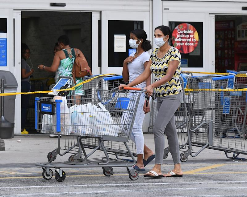 Shoppers at a Walmart in Coconut Creek, Florida, on Saturday as the chain's stores began limiting the number of customers inside. (mpi04/MediaPunch/IPx)