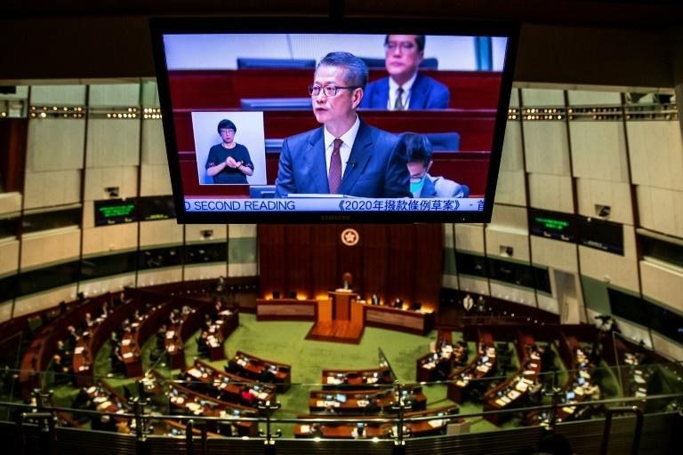 Hong Kong Financial Secretary Paul Chan unveiled a major stimulus package as months of protests and the coronavirus take their toll on the economy (AFP Photo/ISAAC LAWRENCE)