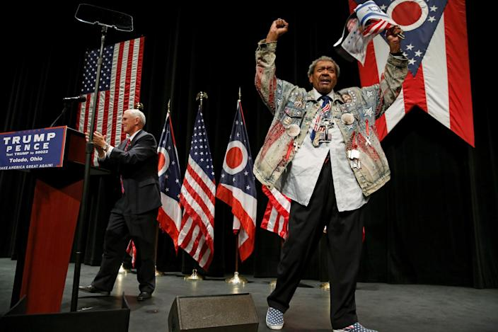 Promoter Don King on stage with Republican vice presidential nominee Mike Pence at a rally with supporters in Toledo, Ohio. (Photo: Jonathan Ernst/Reuters)