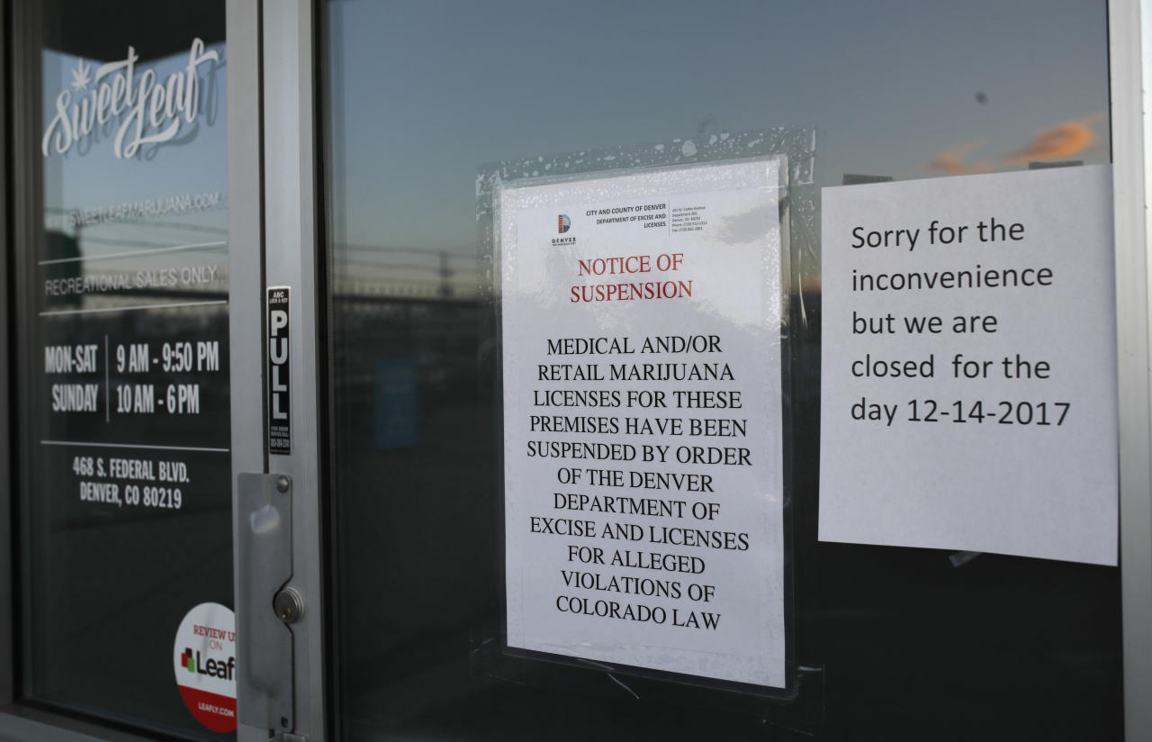 <p> Closed signs are displayed on the front door to a marijuana dispensary along South Federal Boulevard Thursday, Dec. 14, 2017, in south Denver. Twenty-six legal marijuana businesses were closed by Denver officials Thursday amid a police investigation expected to lead to criminal charges. (AP Photo/David Zalubowski) </p>