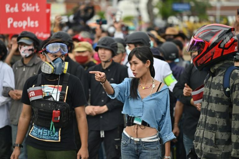 Chonticha 'Lookkate' Jangrew (C) says she has received death threats and 'sexual insults' from ultra-royalists who oppose the protest movement