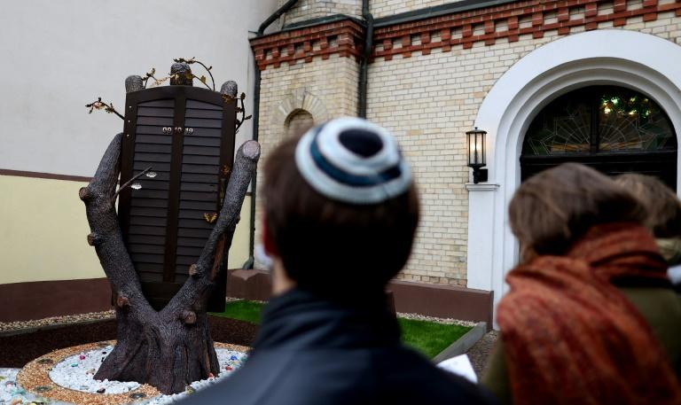 German leaders voice shame as tribute defaced a year after anti-Semitic attack