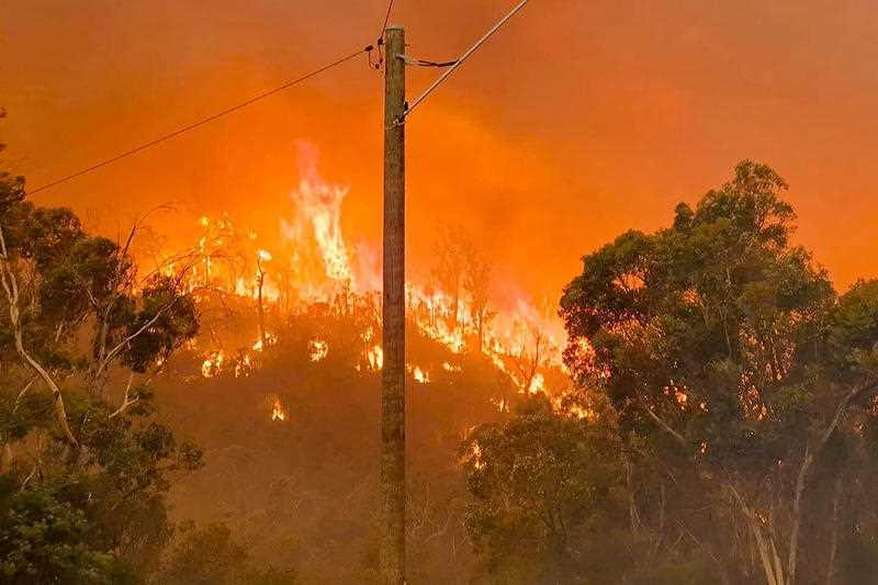 Fire burns on a hill at Wooroloo, near Perth.
