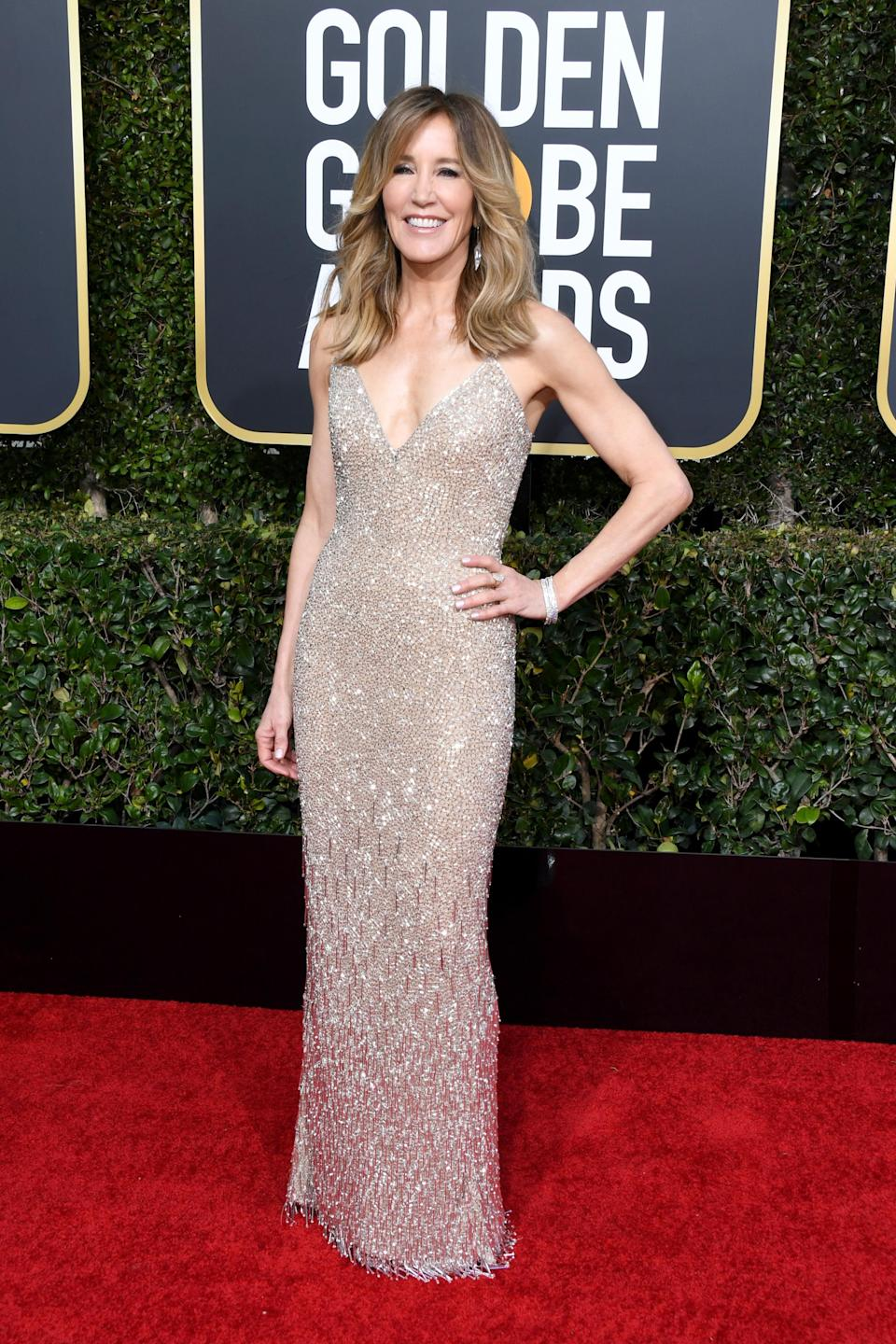 <p>A golden goddess at 56, Felicity Huffman looked gorgeous on the red carpet in a gown by designer Laura Basci. <br>Image via Getty Images. </p>