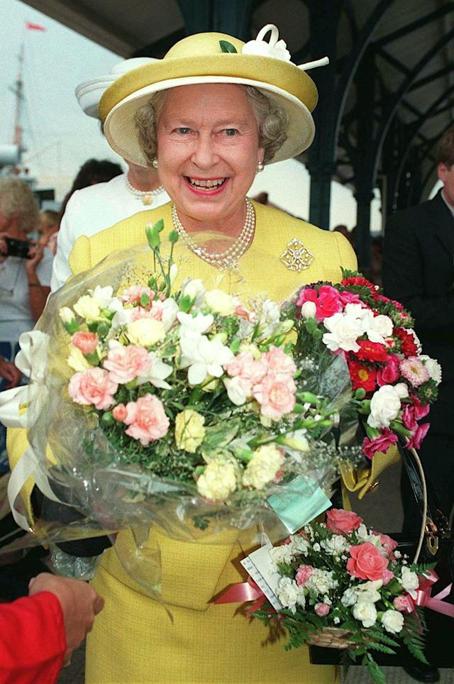 Queen Elizabeth II arrives in Portsmouth clutching flowers from well-wishers, before boarding the Royal Yacht Britannia, August 7. [ This years trip to Balmoral via the Western Isles of Scotland could be the Royal family's last summer holiday aboard the Royal Yacht whose future is uncertain].