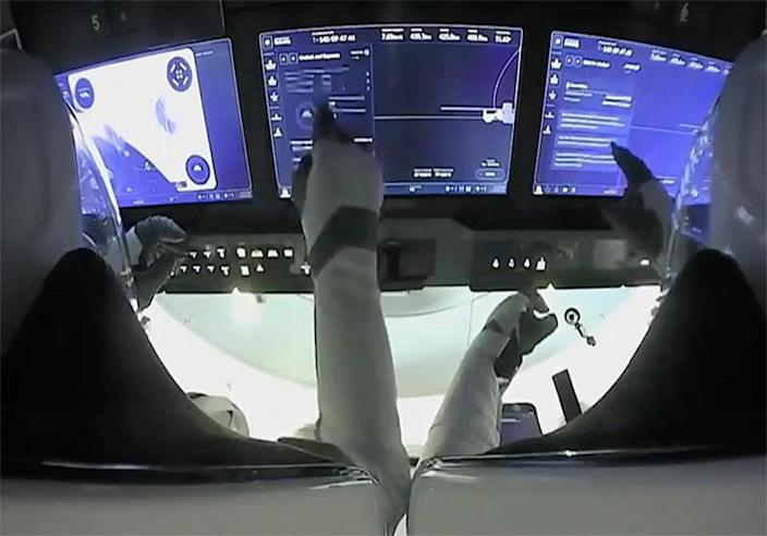 Crew Dragon commanders Mike Hopkins (left) and Victor Glover use the spacecraft's touchscreen display to monitor the progress of the move from one docking port to another, with a new crew coming later this month. Pave the way to arrive. Cargo ship this summer.  & # Xa0; / Credits: NASA TV