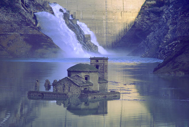 The village of Fabbriche di Careggine lays completely submerged by water as a dam was built next to it. (Getty)