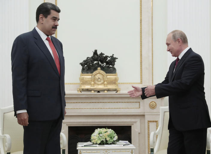 Russian President Vladimir Putin, right, welcomes Venezuela's President Nicolas Maduro during their meeting in the Kremlin in Moscow, Russia, Wednesday Sept. 25, 2019. Nicolas Maduro is on a working visit to Moscow. (Sergei Chirikov/Pool Photo via AP)