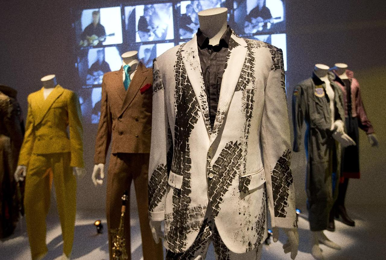 The Alexander McQueen tyre-print suit which David Bowie wore to promote the album' Outside', is photographed as part of a retrospective David Bowie exhibition, entitled David Bowie Is, at the V&A Museum in west London, Wednesday, Mar. 20, 2013, that features 300 objects including handwritten lyrics, original costumes, fashion, photography, film, music videos, set designs and Bowie's own instruments.(Photo by Joel Ryan/Invision/AP)