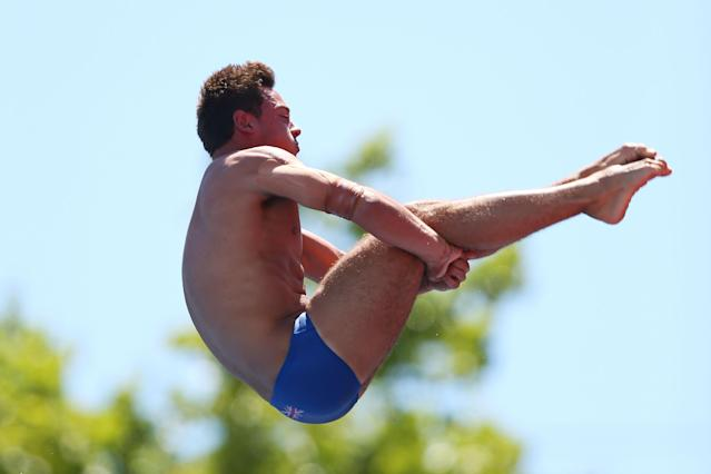 BARCELONA, SPAIN - JULY 28: Tom Daley of Great Britain competes during the Men's 10m Platform Diving final on day nine of the 15th FINA World Championships at Piscina Municipal de Montjuic on July 28, 2013 in Barcelona, Spain. (Photo by Clive Rose/Getty Images)