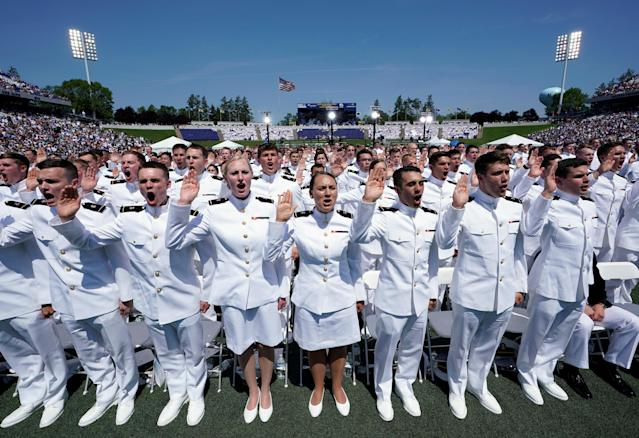 <p>Members of the U.S. Naval Academy graduating class stand to be sworn in during their commissioning and graduation ceremony at the U.S. Naval Academy in Annapolis, Md., May 25, 2018. (Photo: Kevin Lamarque/Reuters) </p>