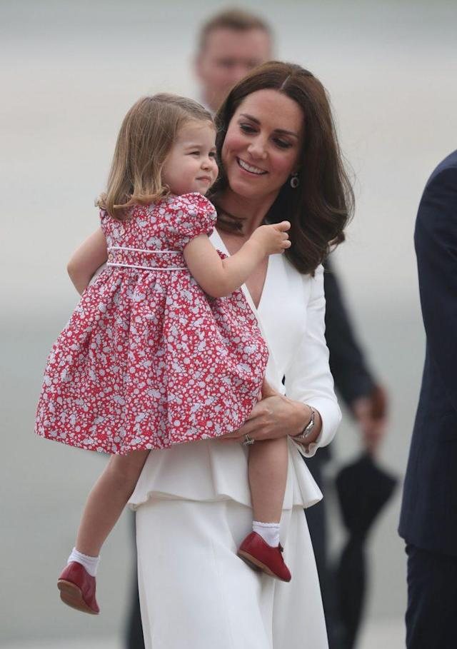 The Duchess of Cambridge wore Alexander McQueen while Charlotte wore a cute red dress. (Photo: PA)