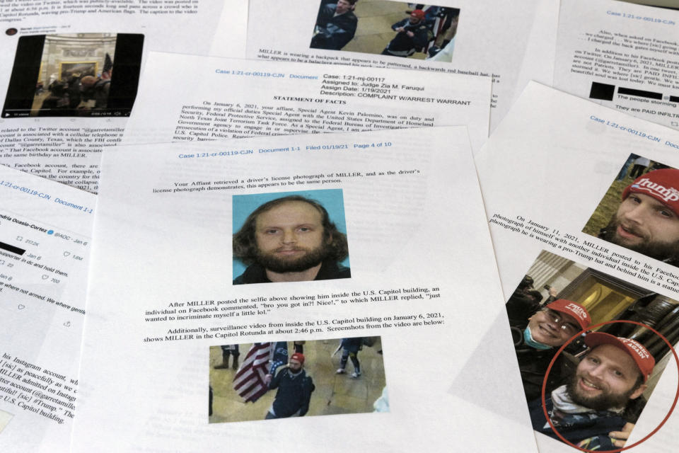 """A statement of facts document presented to the United States District Court in the case against Garret Miller is photographed on Monday, March 29, 2021. Miller didn't speak to the law enforcement officers who arrested him on charges he stormed the U.S. Capitol in January, but the T-shirt he was wearing at his Dallas, home that day sent a clear and possibly incriminating message. Miller's shirt had a photograph of former President Donald Trump and it said, """"Take America Back"""" and """"I Was There, Washington D.C., January 6, 2021,"""" federal prosecutors noted in a court filing on Marc 29. (AP Photo/Jon Elswick)"""