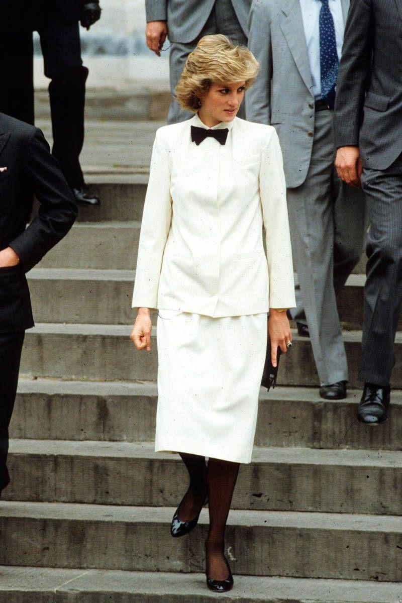 <p>Suited up, black tie style. Diana stands out in a sea of gray suits.</p>