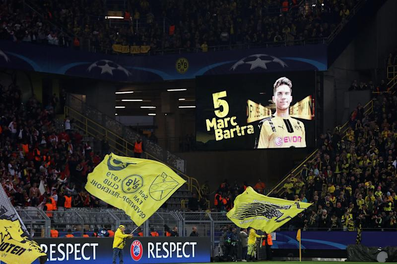 Supporters pay tribute to the injured Bartr: Bongarts/Getty Images