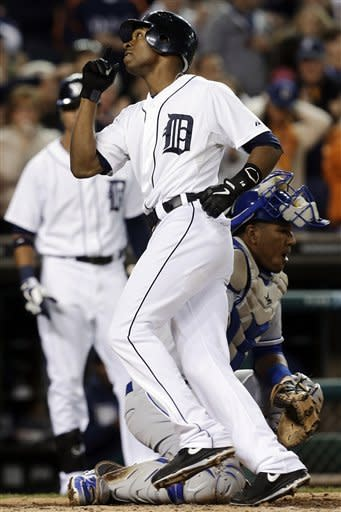 Detroit Tigers' Austin Jackson celebrates his solo home run as Kansas City Royals catcher Salvador Perez looks down in the fourth inning of a baseball game in Detroit, Wednesday, Sept. 26, 2012. (AP Photo/Paul Sancya)