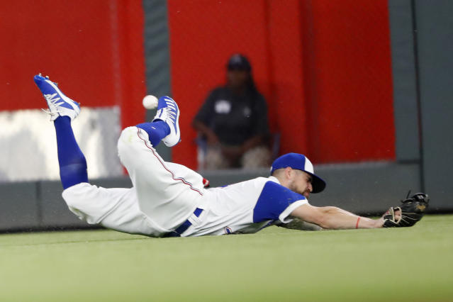 Atlanta Braves center fielder Ender Inciarte dives for a ball hit for a double by Cincinnati Reds' Joey Votto during the sixth inning of a baseball game Thursday, Aug. 1, 2019, in Atlanta. (AP Photo/John Bazemore)