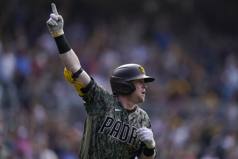 San Diego Padres' Jake Cronenworth watches his walk-off home run hit during the ninth inning of a baseball game against the Houston Astros, Sunday, Sept. 5, 2021, in San Diego. The Padres won, 4-3. (AP Photo/Gregory Bull)