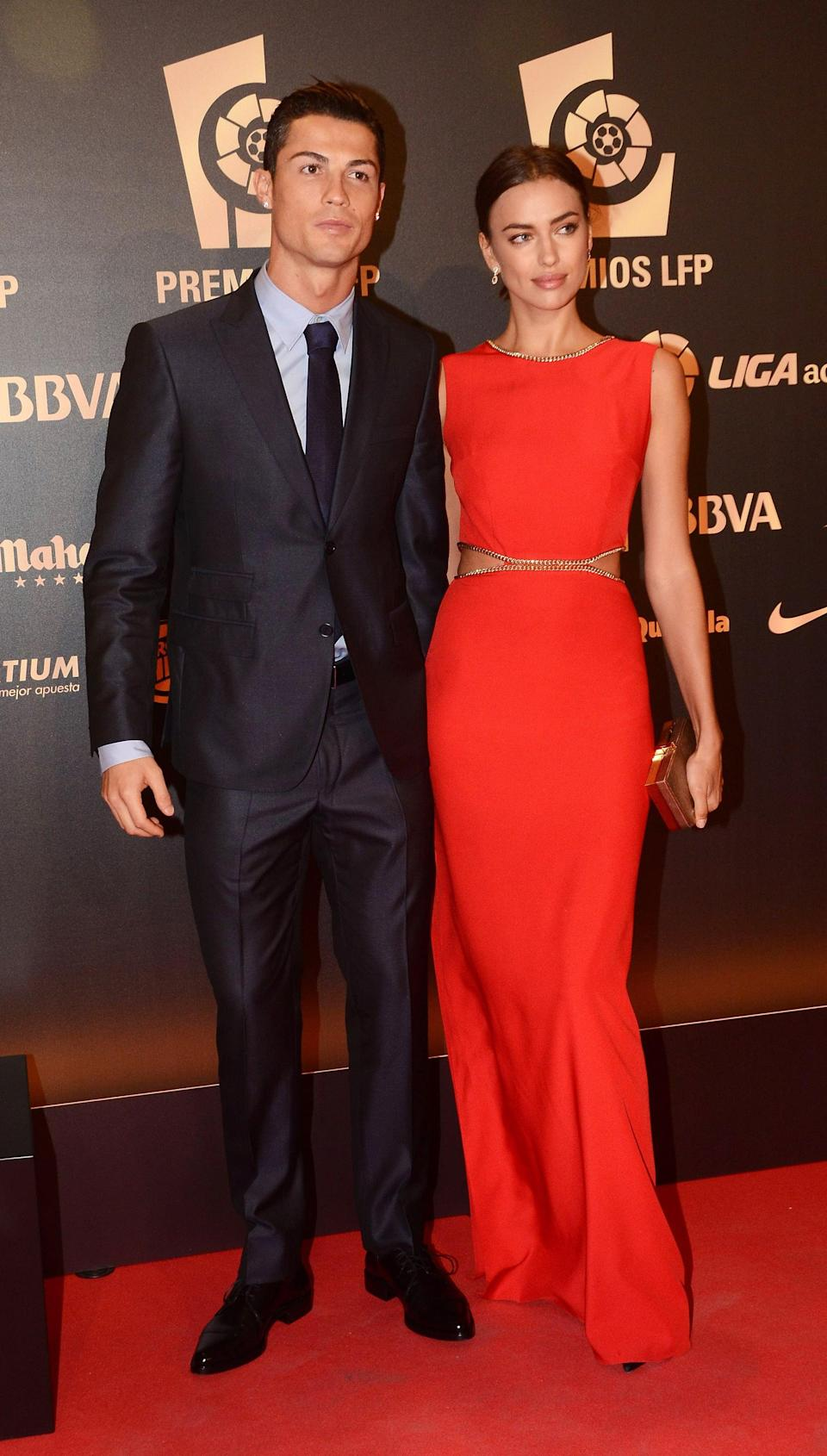 """<p>Shayk's first major public relationship was with Portuguese soccer player Cristiano Ronaldo. According to <strong>US Weekly</strong>, <a href=""""http://www.usmagazine.com/celebrity-news/news/cristiano-ronaldo-irina-shayk-split-after-five-years-of-dating-2015171/"""" class=""""link rapid-noclick-resp"""" rel=""""nofollow noopener"""" target=""""_blank"""" data-ylk=""""slk:the pair met while on set of an Armani ad"""">the pair met while on set of an Armani ad</a> in 2010. Immediately, they became an """"it"""" couple in Hollywood, making red carpet appearances, embracing in PDA, and were even <a href=""""https://twitter.com/VogueSpain/status/468321838159122432"""" class=""""link rapid-noclick-resp"""" rel=""""nofollow noopener"""" target=""""_blank"""" data-ylk=""""slk:photographed together for Vogue España's June issue in 2014"""">photographed together for <strong>Vogue España</strong>'s June issue in 2014</a>. </p> <p>Fans began speculating the two had split after Ronaldo didn't accompany Shayk to the premiere of <strong>Hercules</strong> in 2014, and Shayk was absent at the annual FIFA Ballon d'Or in 2015. On January 2015, <strong>US Weekly</strong> confirmed the two had called things off for good. Though neither person explicitly gave an explanation for their split, that same year Shayk told Spanish magazine <strong>Hola!</strong> that her number one relationship rule is faithfulness and honesty, leading many to believe <a href=""""http://www.mirror.co.uk/sport/football/news/irina-shayk-attacks-cristiano-ronaldo-5816133"""" class=""""link rapid-noclick-resp"""" rel=""""nofollow noopener"""" target=""""_blank"""" data-ylk=""""slk:there may have been infidelity"""">there may have been infidelity</a> in their relationship.</p>"""