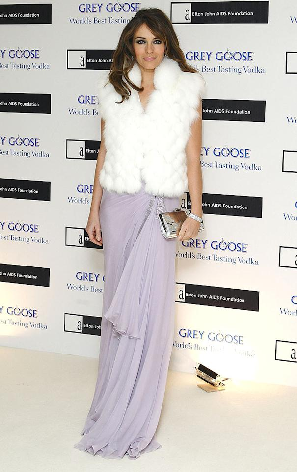 "Elizabeth Hurley was festive in a long lilac gown and a white fur gilet at the Grey Goose Character & Cocktails winter fundraiser to benefit the Elton John AIDS Foundation in London. We're loving the daring contrast between the fluffy fur and the chiffon dress! Mike Marsland//<a href=""http://www.wireimage.com"" target=""new"">WireImage.com</a> - December 13, 2009"