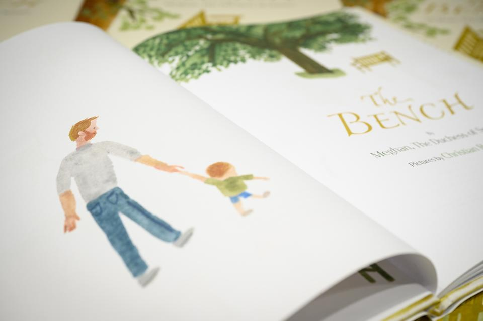 LONDON, ENGLAND - JUNE 08: A illustration of a father and son are seen inside a copy of Meghan Markle's book