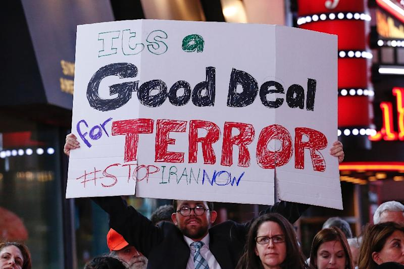 A man holds a poster during a rally against the nuclear deal with Iran in Times Square in New York on July 22, 2015 (AFP Photo/Kena Betancur)