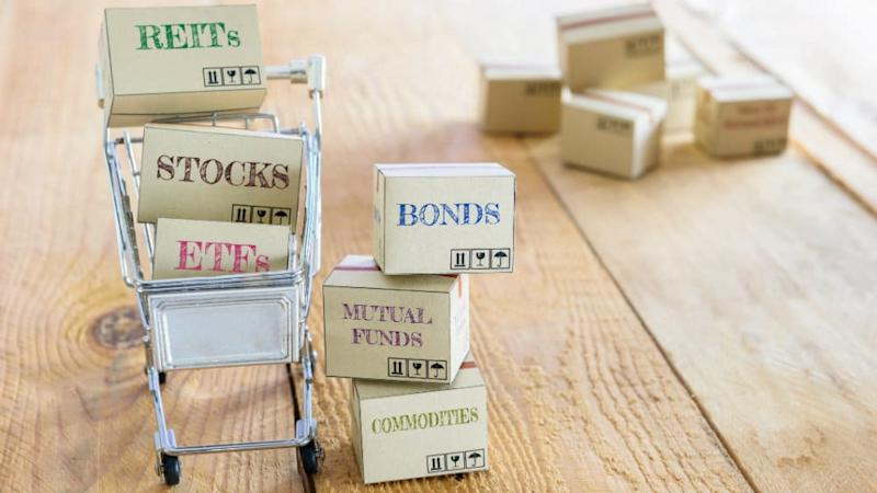 Shopping cart with boxes labelled REITs, ETFs, Bonds, Stocks
