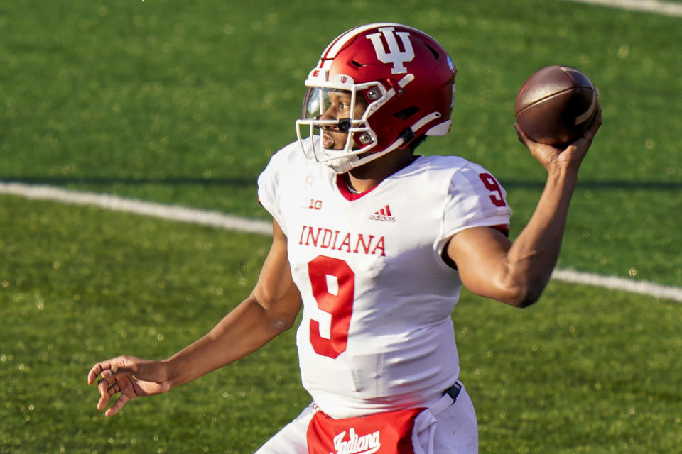 FILE — In this Oct. 31, 2020, file photo, Indiana quarterback Michael Penix Jr. throws a pass during the second quarter of the team's NCAA college football game against Rutgers in Piscataway, N.J. Penix is back from a season-ending knee injury as the team returns to play this season. (AP Photo/Corey Sipkin, File)