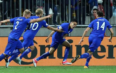 Finland's Pyry Soiri celebrates scoring their first goal with teammates   REUTERS/Antonio Bronic