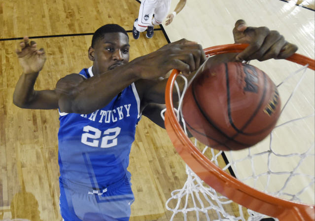 Kentucky forward Alex Poythress dunks the ball during the first half of the NCAA Final Four tournament college basketball championship game against Connecticut Monday, April 7, 2014, in Arlington, Texas. (AP Photo/Chris Steppig, pool)