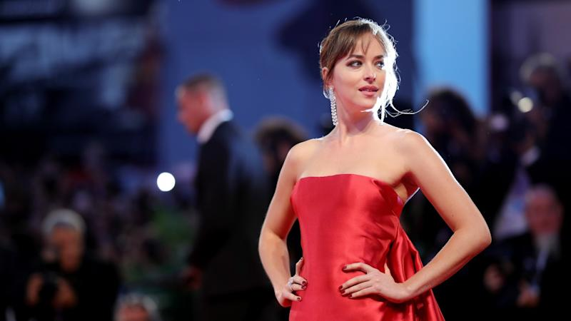Dakota Johnson Is a Vision in Red at Venice Film Festival -- See the Mesmerizing Gown