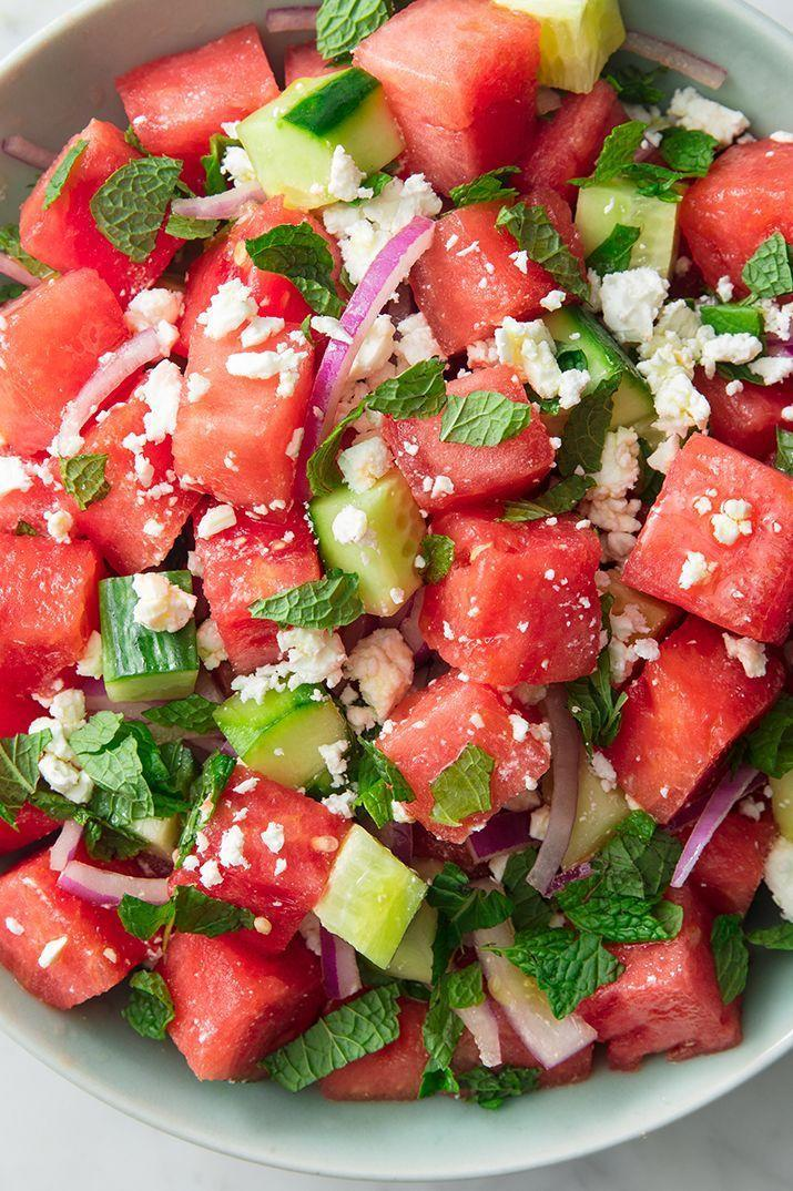 """<p>Watermelon + cucumbers is one of the most refreshing combos of all time. Throw in some mint, red onion, and feta and toss it all with a very simple vinaigrette (just olive oil + red wine vinegar), and you've got yourself a mean summer salad. It's the perfect <a href=""""https://www.delish.com/uk/cooking/recipes/g32708558/vegetarian-side-dishes/"""" rel=""""nofollow noopener"""" target=""""_blank"""" data-ylk=""""slk:summer side"""" class=""""link rapid-noclick-resp"""">summer side</a> to go along <a href=""""https://www.delish.com/uk/cooking/recipes/a28841199/best-grilled-chicken-breast-recipe/"""" rel=""""nofollow noopener"""" target=""""_blank"""" data-ylk=""""slk:grilled chicken"""" class=""""link rapid-noclick-resp"""">grilled chicken</a> or even a <a href=""""https://www.delish.com/uk/cooking/recipes/g30993382/best-burger-recipes/"""" rel=""""nofollow noopener"""" target=""""_blank"""" data-ylk=""""slk:hamburger—beef, chicken, or veggie"""" class=""""link rapid-noclick-resp"""">hamburger—beef, chicken, or veggie</a>! </p><p>Get the <a href=""""https://www.delish.com/uk/cooking/recipes/a32998257/watermelon-salad-feta-mint-recipe/"""" rel=""""nofollow noopener"""" target=""""_blank"""" data-ylk=""""slk:Watermelon Feta Salad"""" class=""""link rapid-noclick-resp"""">Watermelon Feta Salad</a> recipe.</p>"""