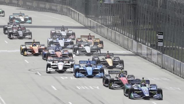 Alexander Rossi leads the field at the start of the second race of the IndyCar Detroit Grand Prix auto racing doubleheader, Sunday, June 3, 2018, in Detroit. (AP Photo/Carlos Osorio)