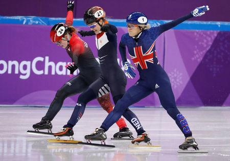 REFILE - ADDING BYLINE Short Track Speed Skating Events – Pyeongchang 2018 Winter Olympics – Women's 500m Semifinal – Gangneung Ice Arena - Gangneung, South Korea – February 13, 2018 - Elise Christie of Britain, Yara van Kerkhof of the Netherlands and Kim Boutin of Canada in action. REUTERS/Damir Sagolj