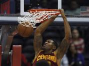 Cleveland Cavaliers forward Alonzo Gee (33) scores against the Atlanta Hawks during the first half of an NBA basketball game, Friday, Nov. 30, 2012, in Atlanta. (AP Photo/John Bazemore)
