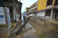 An electric pole lays on its side after the passing of Hurricane Pamela in Mazatlan, Mexico, Wednesday, Oct. 13, 2021. Pamela made landfall on Mexico's Pacific coast just north of Mazatlan on Wednesday, bringing high winds and rain to the port city. (AP Photo/Roberto Echeagaray)