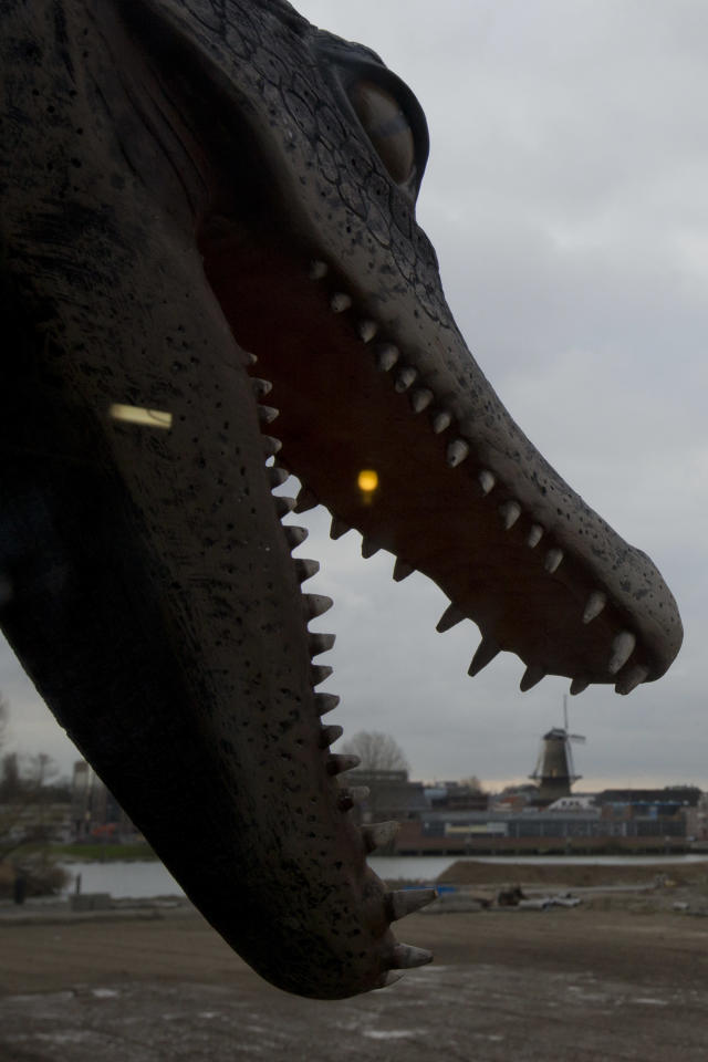 A life-size replica of a crocodile's mouth is suspended from the full scale replica of Noah's Ark which opened its doors in Doredrecht, Netherlands, Monday Dec. 10, 2012, after receiving permission to receive up to 3,000 visitors per day. (AP Photo/Peter Dejong)