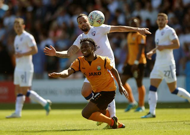 """Soccer Football - League Two - Barnet vs Chesterfield - The Hive, London, Britain - May 5, 2018 Barnet's Shaquile Coulthirst in action with Chesterfield's Robbie Weir Action Images/Adam Holt EDITORIAL USE ONLY. No use with unauthorized audio, video, data, fixture lists, club/league logos or """"live"""" services. Online in-match use limited to 75 images, no video emulation. No use in betting, games or single club/league/player publications. Please contact your account representative for further details."""